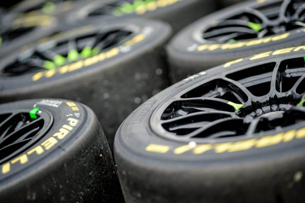 close up of used racing tyres