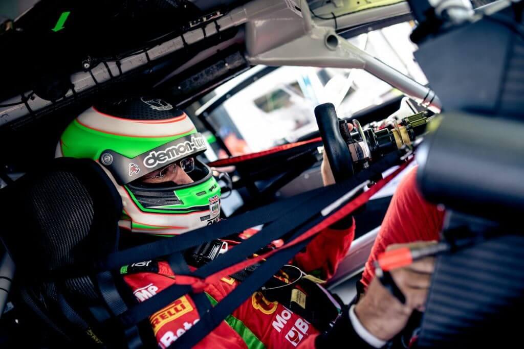 demon tweeks racing driver in the cockpit