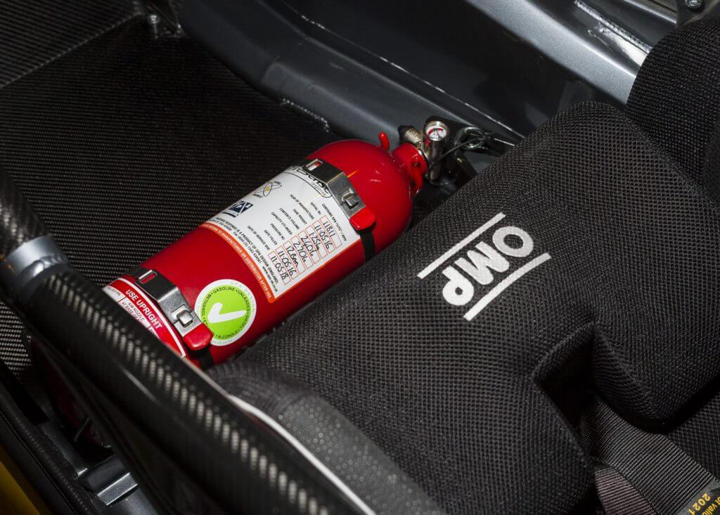 fire extinguisher under racing seat