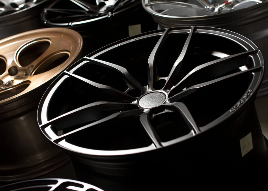 Close up of alloy wheels with no tyres