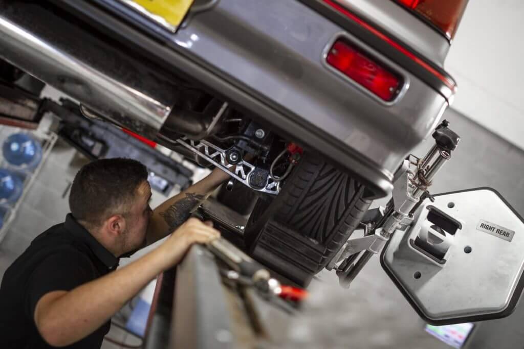 mechanic underneath a third generation honda civic